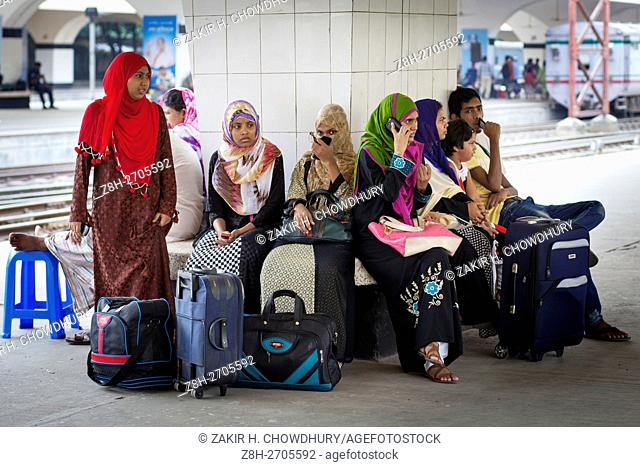 DHAKA, BANGLADESH - JUNE 30 :Bangladeshi people waiting for train to travel their village to celebrate festival Eid al-Fitr in Dhaka, Bangladesh on June 30