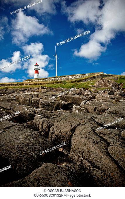 Lighthouse on rocky hill