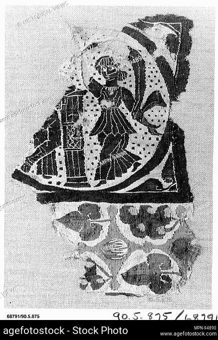 Fragment with Two Figures. Object Name: Panel fragment; Date: 5th-6th century; Geography: Attributed to Egypt; Medium: Linen, wool; Dimensions: 9 1/4 in