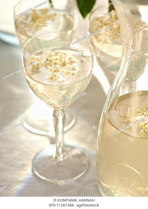 Elderflower syrup in glasses and a carafe