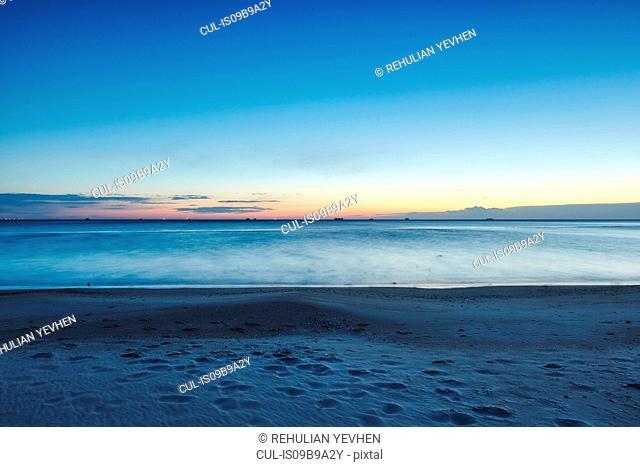 Sunset over sea from beach Odessa, Odessa Oblast, Ukraine, Europe