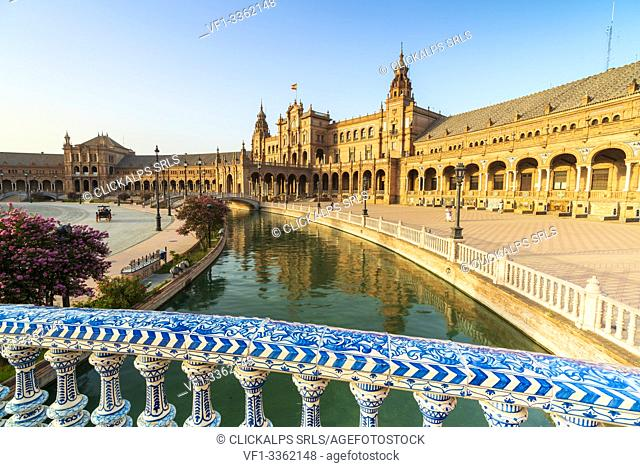 Overview of canal and portico from a decorated glazed ceramic balustrade, Plaza de Espana, Seville, Andalusia, Spain