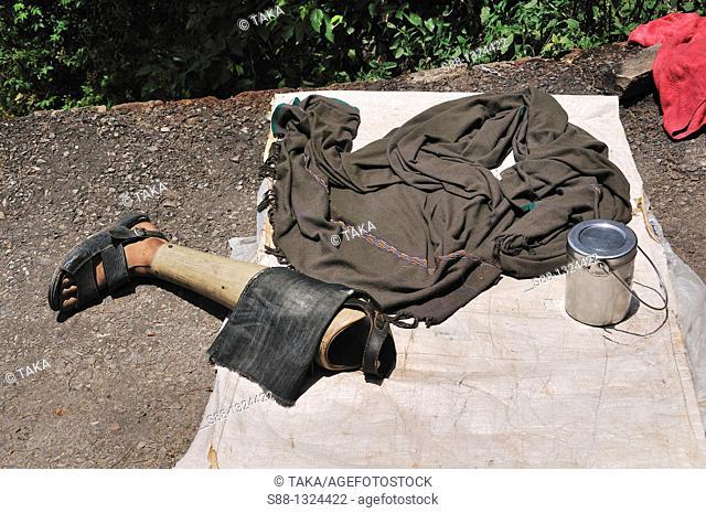 Prosthetic leg by the quiet street. McLeod Ganj, Dharamsala, India