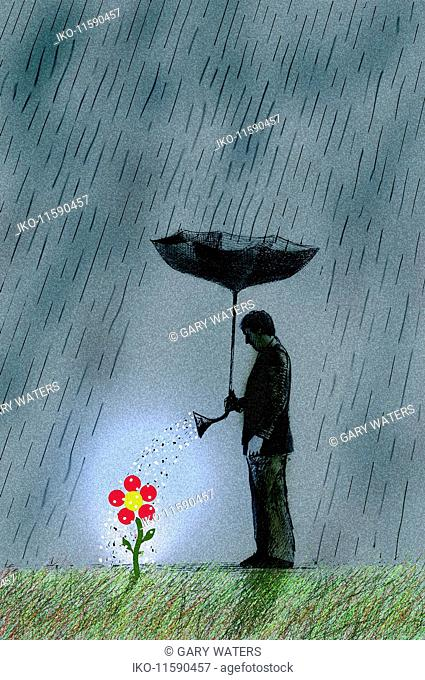 Businessman in storm watering flower with upside-down umbrella