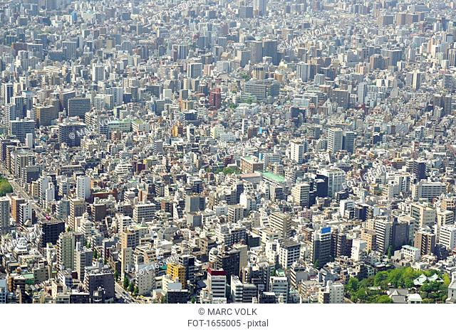 Aerial view of crowded cityscape on sunny day, Tokyo, Japan