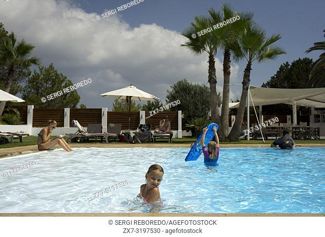 Gecko luxury boutique Hotel, Migjorn beach, Formentera Island, Balearic Islands, Spain, Europe. Girls in the swimming pool