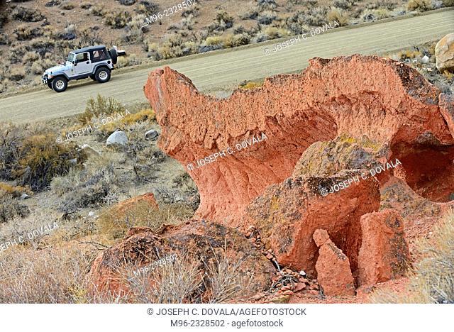 Jeep passing odd formations, Mojave Desert, California, USA