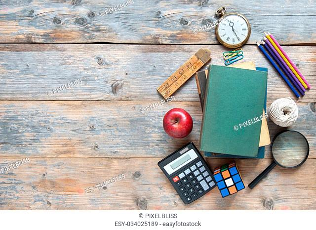 School stationery accessories on a wooden table with space for text