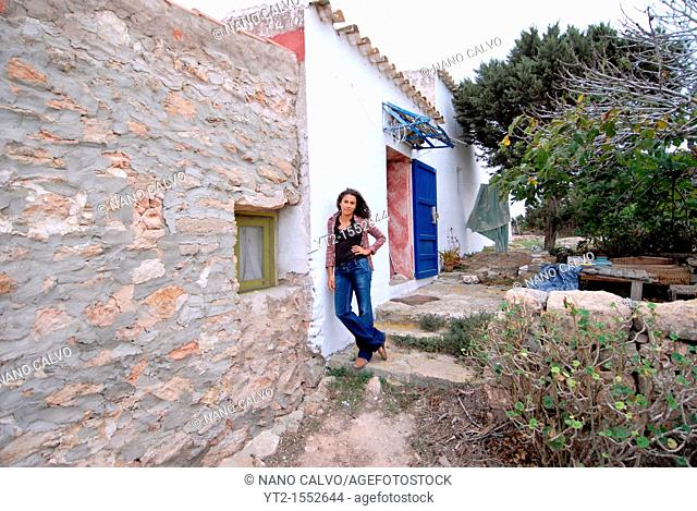 Brazilian woman posing at her house in Formentera, Spain
