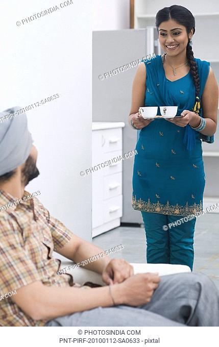 Woman bringing tea for her husband