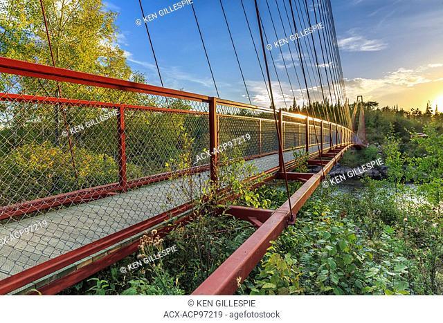 Trans Canada Trail suspension bridge over the Whiteshell River, Whiteshell Provincial Park, Manitoba, Canada