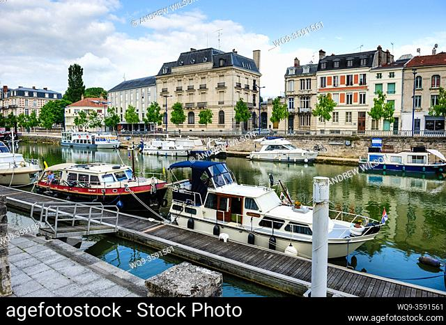 Pleasure boats tied up at the Quai de Londres on the River Meuse in Verdun, France