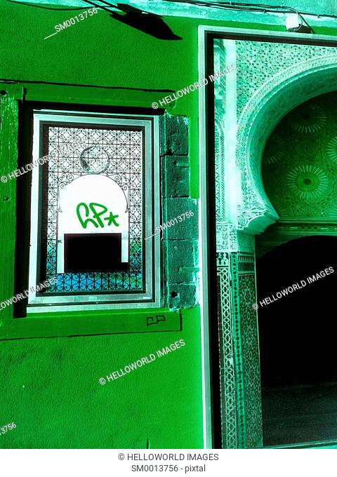 Green decorative window and entrance, France, Europe