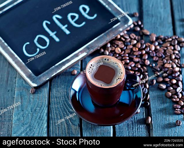 coffee beans on the wooden table, coffee background