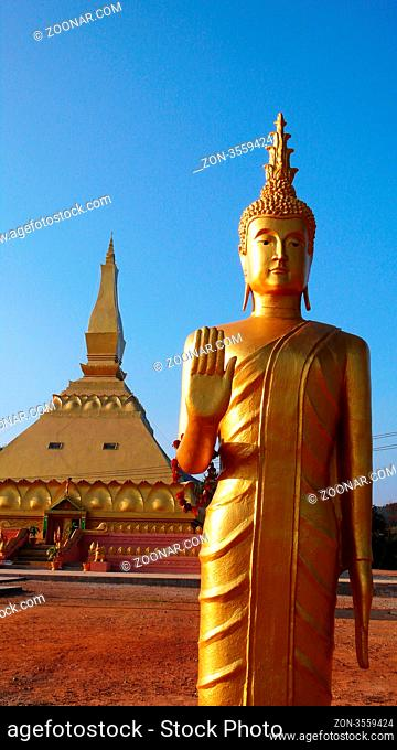 Landmark of famous historic golden Buddha sculpture and temple in Laos