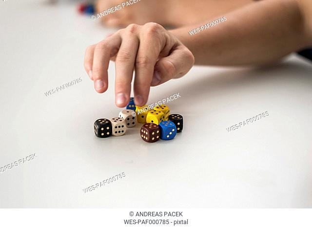 Vocational school student with dice