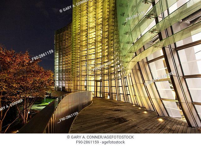 The National Art Center Tokyo exterior in the evening, Roppongi, Tokyo, Japan (architect Kisho Kurokawa)