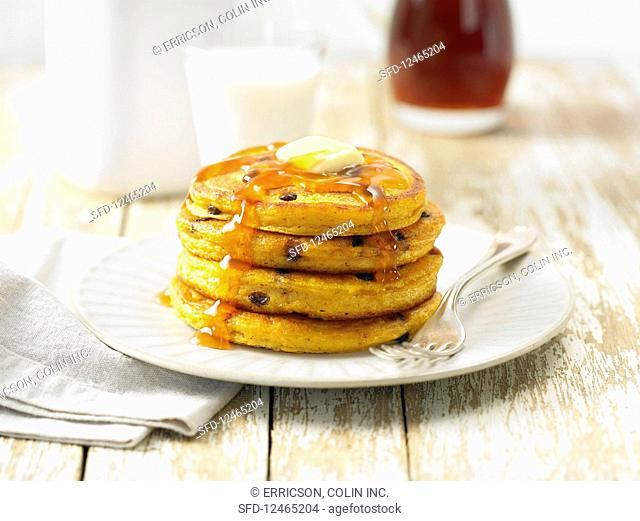 Pumpkin pancakes with chocolate drops and maple syrup