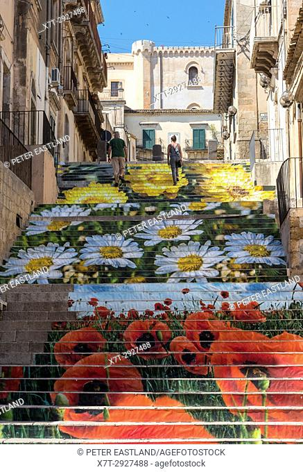 A stairway in a side street decorated for the flower festival in the old baroque town of Noto in South Eastern Sicily. Italy
