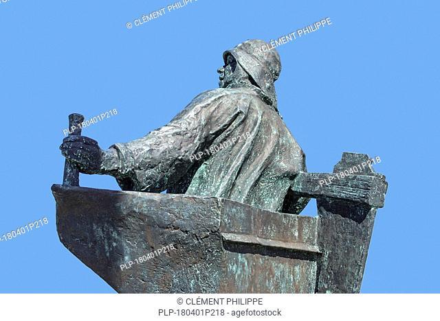 Statue De Stuurman / Sterken Dries showing fisherman at the helm at seaside resort Blankenberge along the North Sea coast, West Flanders, Belgium