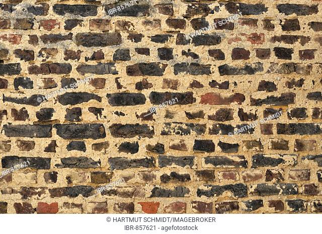 Old brick wall with thick mortar joints