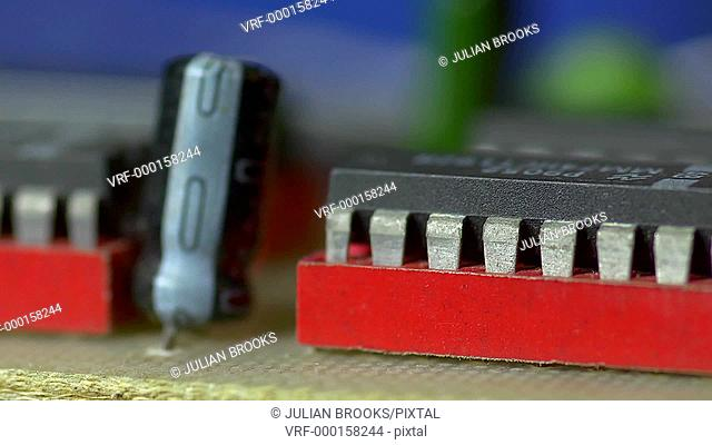 slow track along electronic components, shallow DOF