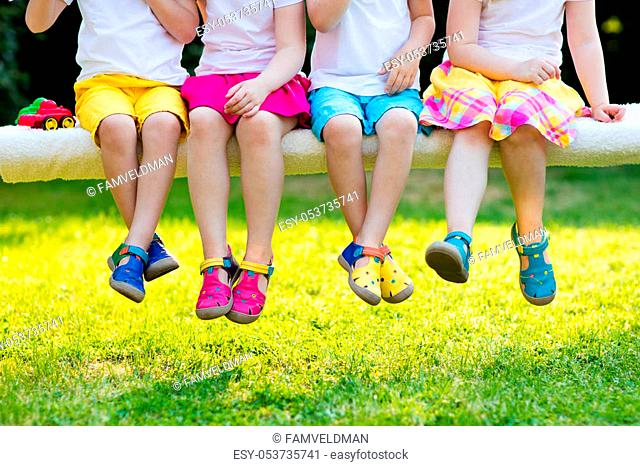 Footwear for children. Group of preschool kids wearing colorful leather shoes. Sandal summer shoe for young child and baby