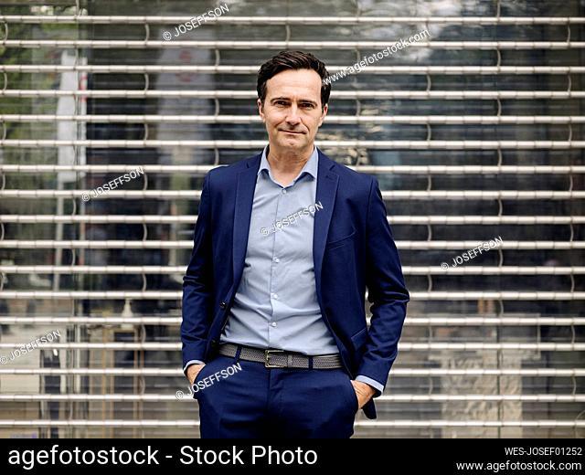 Portrait of a confident mature businessman at a facade