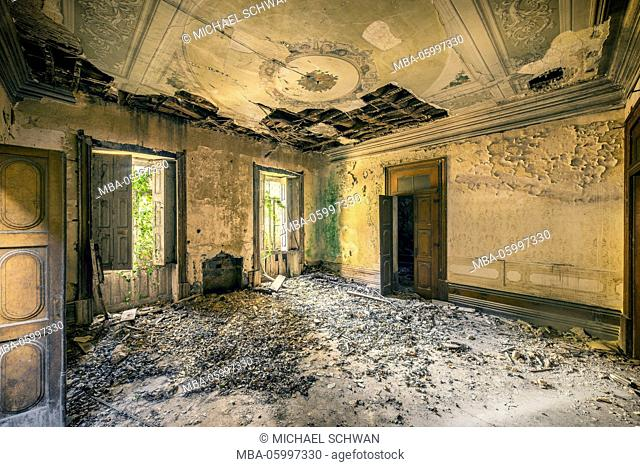 empty room in a derelicted castle with collapsed ceiling