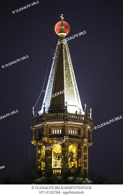 Moon eclipse on 27 july 2018 behind the bell tower of Lecco, Lecco province, Lombardy, Italy