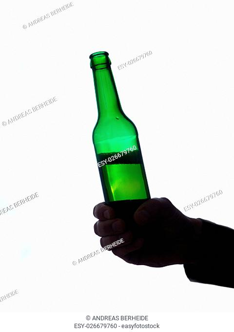 Man with a bottle of beer on a white background