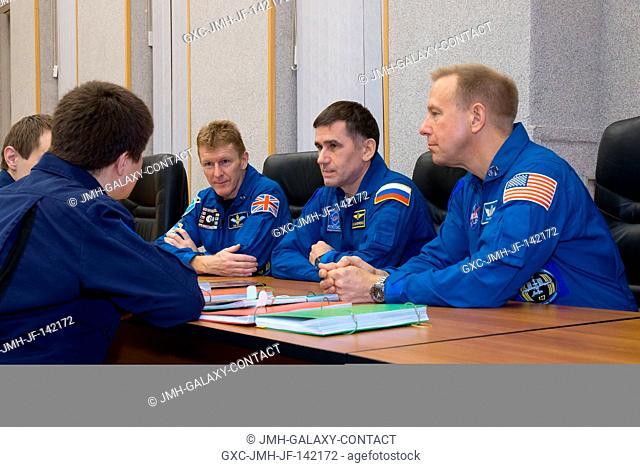 At their Cosmonaut Hotel crew quarters in Baikonur, Kazakhstan, Expedition 46-47 crewmembers Tim Peake of the European Space Agency (left)