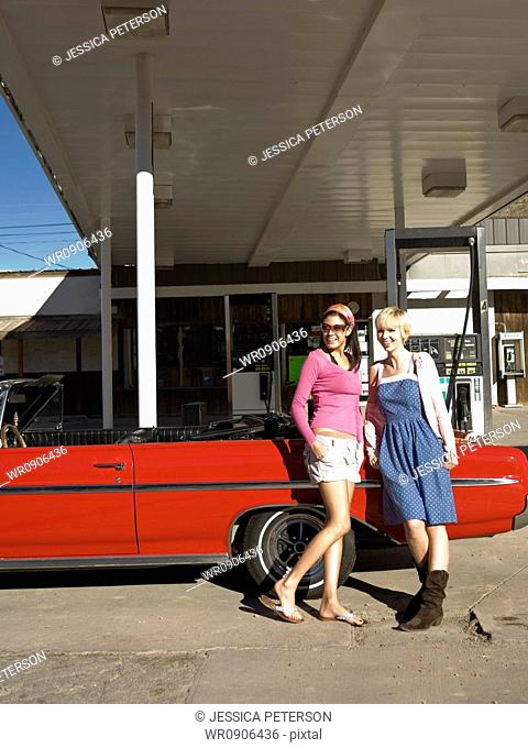 two women at a gas station