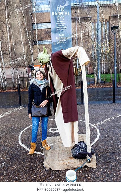 England, London, Southwark, Bankside, Female Tourist and Human Statue