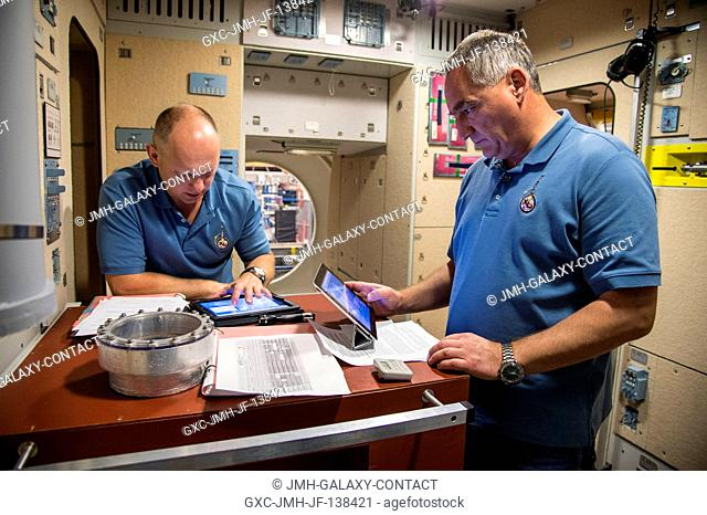 Russian cosmonauts Oleg Artemyev (left) and Alexander Skvortsov, both Expedition 3940 flight engineers, participate in an emergency scenario training session in...