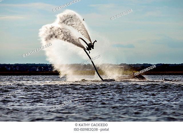 Person flyboarding in ocean, Seaside Heights, New Jersey, USA