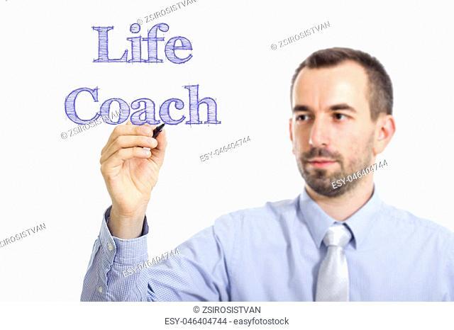 Life Coach - Young businessman writing blue text on transparent surface - horizontal image