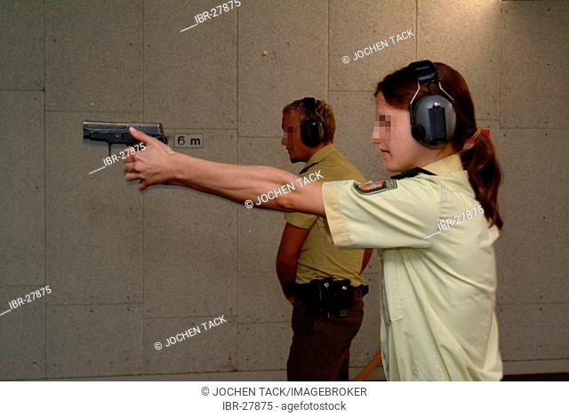 DEU, Germany, Essen : German police officer in a training shooting range. Different movies and situations are shown and the officers have to react in the right...