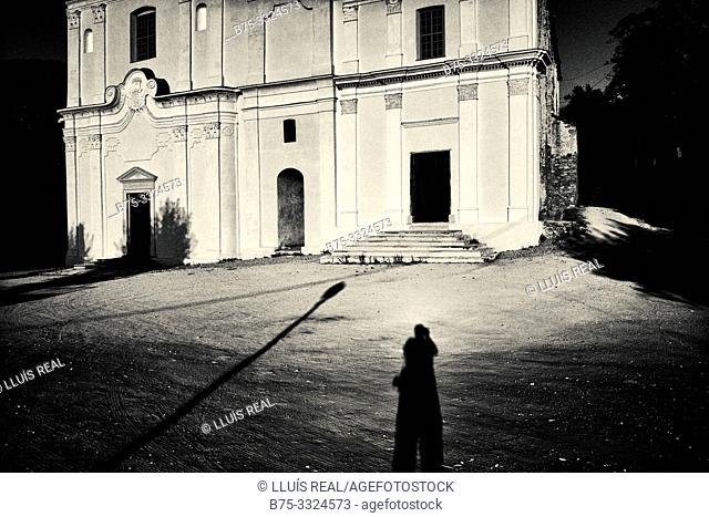 Photographer's selfie photographing the Iglesia de San Giovanni Evangelista (siglo xvi) Santo- Pietro-de Tenda, Corsica, France, Europe