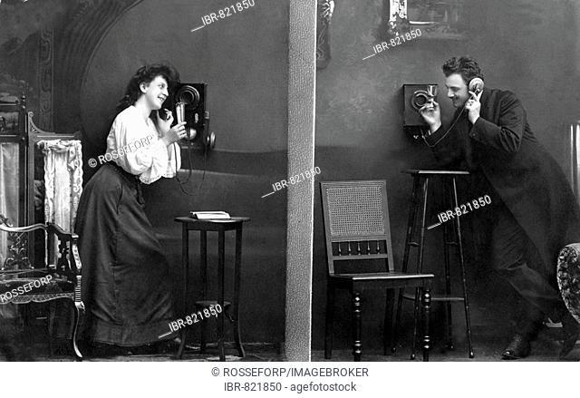 Man and woman telephoning, historical photo, circa 1915