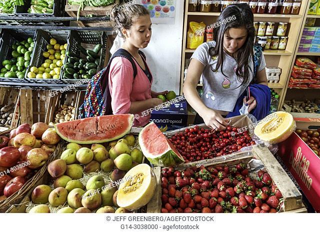 Argentina, Buenos Aires, Verduleria de las Luces, greengrocer, produce market, fruit crates, pears, mellon, cherries, strawberries, display sale, woman