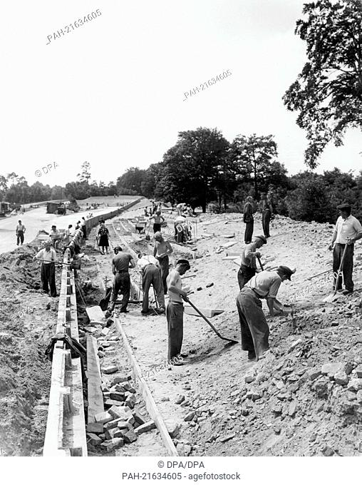 Workers reconstruct the Avus road in Berlin, Germany, in the spring of 1951. The Avus was the site of Germany's first car race after the end of the 2nd World...