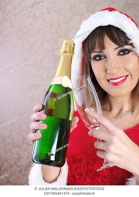 Young woman dressed Mama Claus showing a glass and champagne