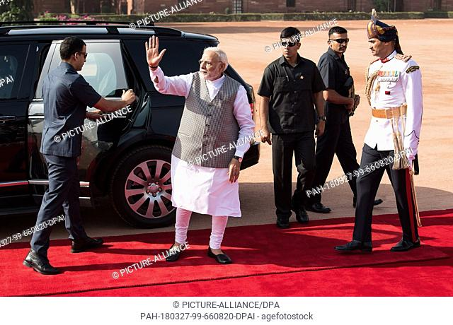 24 March 2018, Germany, New Delhi: The Indian Prime Minister Narendra Modi arrives in an armoured Range Rover at the official residence of the Prime Minister in...