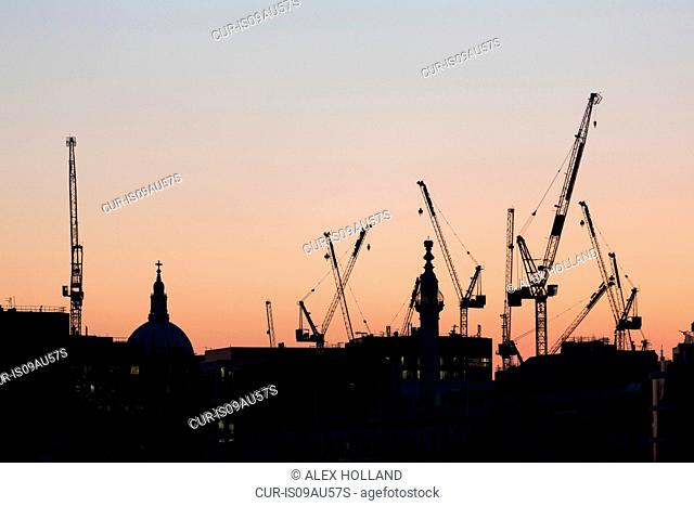 St Paul's Cathedral at dusk, surrounded by consruction cranes, London, England, UK