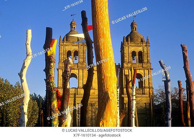 `Bosque Encantado', enchanted Forest, by Agustín Ibarrola Goicoechea, in background Santísima Trinidad church, Salamanca, Spain