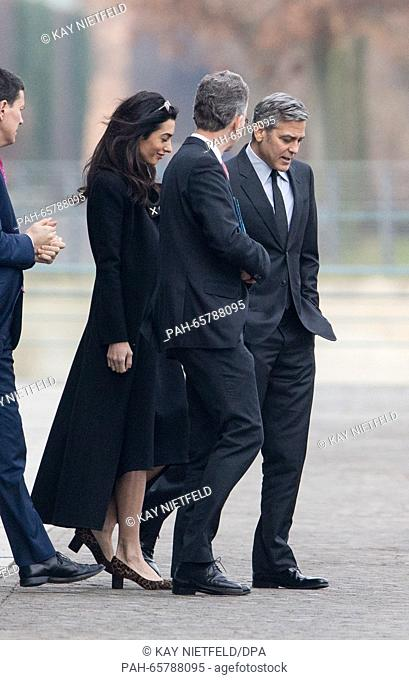 USactor George Clooney (R) and his wife Amal (2-L)leave after a talk with German Chancellor Angela Merkel (not pictured) at the German Federal Chancellery...