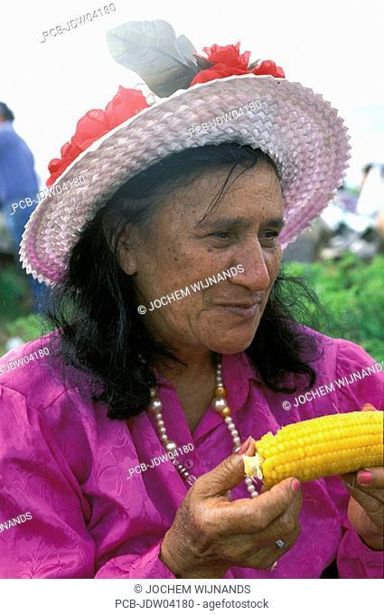 Rapa Nui woman eating corn