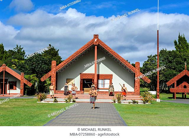 Traditional dressed Maoris in front of the Te Puia Maori Cultural Center, Roturura, North Island, New Zealand
