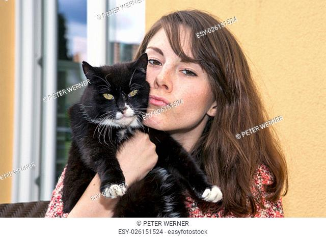 portrait of a young woman with her cat